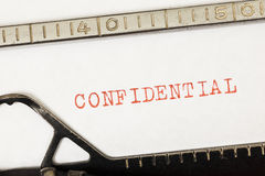 Confidential written in red on old typewriter Royalty Free Stock Images
