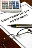 Confidentiality Agreement. Image of a confidentiality agreement on an office table Royalty Free Stock Images