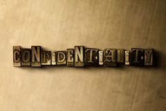 CONFIDENTIALITY - close-up of grungy vintage typeset word on metal backdrop Stock Photography