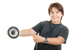 Confidently boy posing and happy holding speaker bass while show. Cute young male chubby kid or boy smiling and confidently posing and happy holding speaker bass Stock Photo