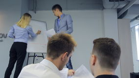 Confidently looked man spreads paper handouts on conference. stock video footage