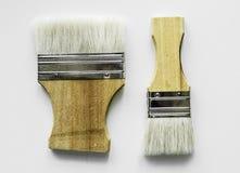 Configuração lisa das escovas isoladas no fundo branco fotografia de stock