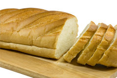 Configurações do pão branco em uma placa de desbastamento Foto de Stock Royalty Free