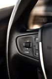 Configurable buttons on vehicle steering wheel Stock Photo