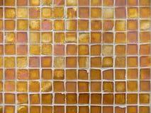 Configuration de fond des tuiles en verre d'orange et d'en cuivre Photos libres de droits