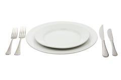 Configuration de place avec la plaque, le couteau et la fourchette à haute brillance Photo libre de droits