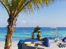 Configuration de Tableau au restaurant de plage photo stock