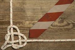 Configuration en bois attachée d'appartement de fond de coeur de noeud de mer Image libre de droits
