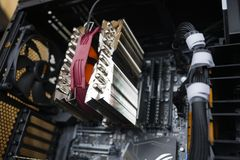 The configuration of the machine: motherboard, CPU, heatsink, cooler. Selective focus royalty free stock image