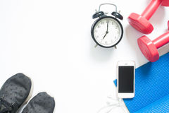 Configuration plate de smartphone avec les équipements et l'horloge de yoga de sport Photo libre de droits