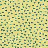 Configuration sans joint Coeurs bleus et verts minuscules Répétition abstraite Image stock