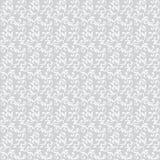 Configuration sans joint légère Le blanc tourbillonne avec le feuillage d'isolement sur un fond gris Photographie stock