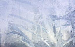 Configurations de glace sur la glace de l'hiver Fond congelé par Noël Hiver modifiant la tonalité l'effet photographie stock libre de droits