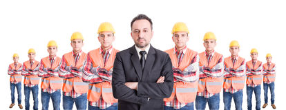Confindent business man and a team of construction workers Royalty Free Stock Photos