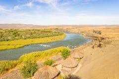 Confine arancio del fiume Namibia e del Sudafrica Fotografia Stock