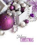 Confine d'argento e porpora degli ornamenti di Natale Fotografia Stock