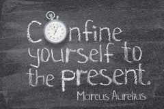 Confine to present watch. Confine yourself to the present - ancient Roman philosopher Marcus Aurelius concept quote written on chalkboard Royalty Free Stock Photography