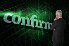 Confirm against green and black circuit board Stock Photography