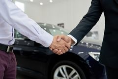 Confirming deal. Customer and seller shaking hands to confirm a deal Royalty Free Stock Photo