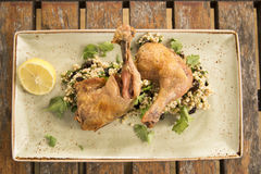 Confit Chicken with lemon, olive & herb cous cous Stock Photo