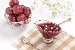 Confiture de prune avec le thé Photo stock