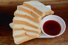 Confiture et pain Photo stock
