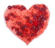 Confiture rouge sous forme de coeur d'isolement sur le blanc Photographie stock libre de droits