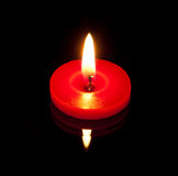 A conflagrant candle Royalty Free Stock Image