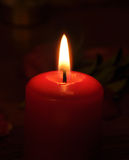 A conflagrant candle is in darkness Royalty Free Stock Images