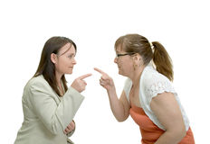 Conflict. Conflict between two women, pointing fingers at each other Stock Images