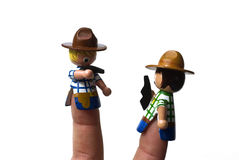 Conflict. Concept, finger puppets in cowboy outfit dueling stock image