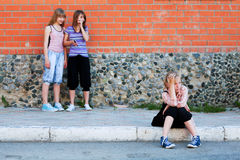 Teen girls in conflict at the school building Stock Images