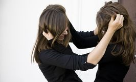 Conflict. Two Teenager Girls Fighting Outdoors stock image