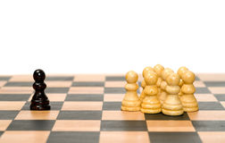 Conflict. A small group of white chess pawns separated from a single chess piece Stock Photography