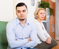 Conflict of aged woman and young guy Royalty Free Stock Image