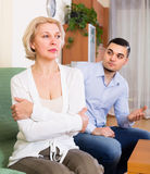 Conflict of aged woman and young guy Royalty Free Stock Photography