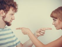Couple pointing fingers at each other, conflict Royalty Free Stock Image