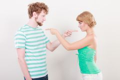 Couple pointing fingers at each other, conflict Stock Images