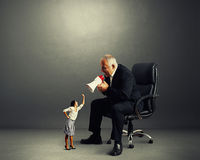 Conflict between businesswoman and businessman Stock Image