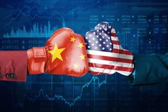 Conflict between China and USA. Two hands of business people wearing boxing gloves with China and USA flag. Shot with trade stock background stock illustration