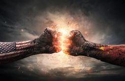 Conflict, close up of two fists hitting each other over dramatic Stock Photos