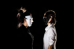 Conflict confrontation between beautiful woman in black mask and Stock Photography