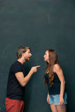 The conflict of couple. Women threatening and showing strength on dark background stock photos