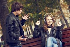 Relationship trouble or problem. Depressed man and funny woman Stock Image