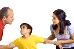 Conflict in family. Hands of parents fighting over their son each pulling him their way royalty free stock photo