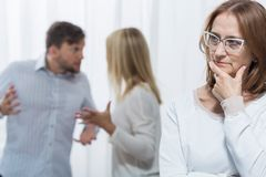 Conflict in family. Psychologist is concerned about conflict in family royalty free stock photos