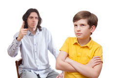 The conflict between father and his son. Isolated on white background royalty free stock photos