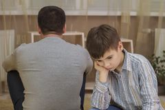 Conflict between father and son, family relations. royalty free stock image