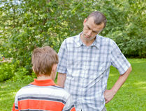 Conflict of father and son, park Royalty Free Stock Photography