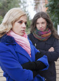 Conflict among friends. Girlfriends have a conflict on outdoors in autumn Royalty Free Stock Photos